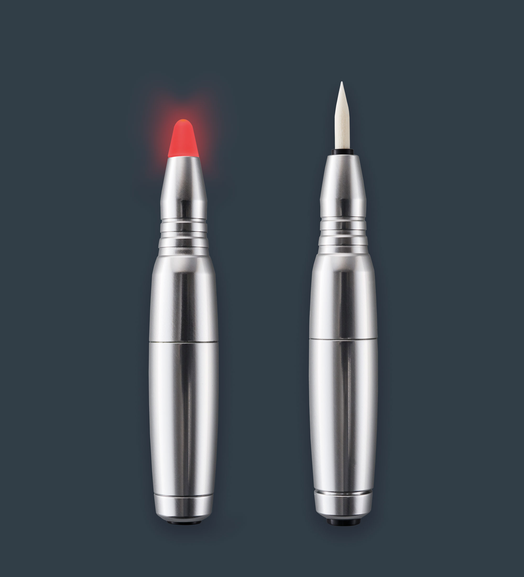 Two different amiea accessories, control pen and a soft laser and pen, on a grey background