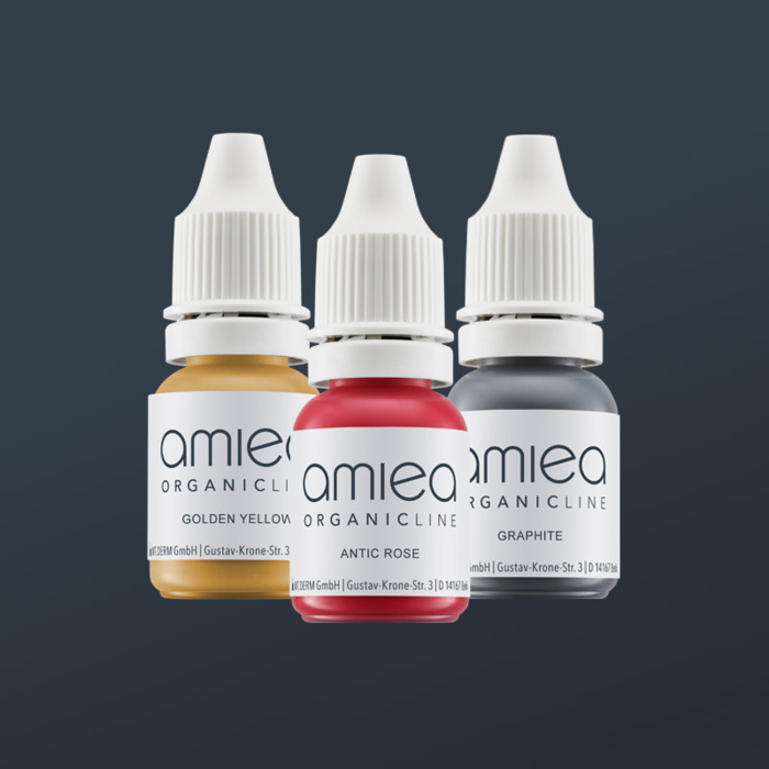 Three bottles of amiea organicline colors, on grey background
