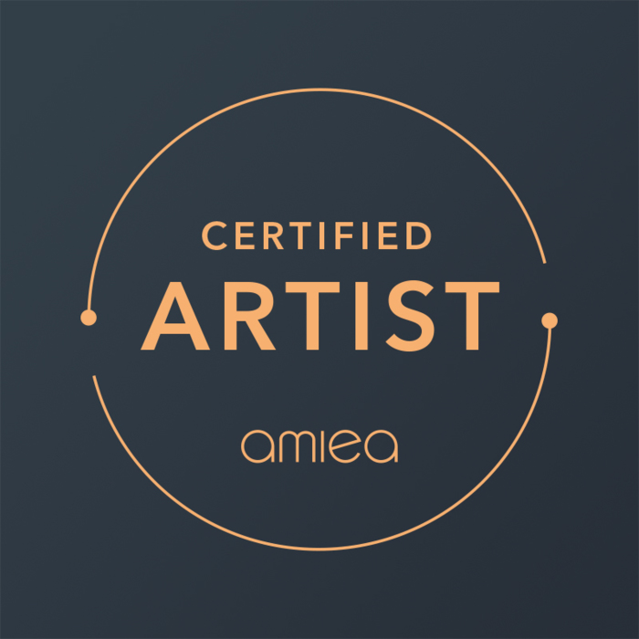 Icon for amiea certified artist on a dark grey background
