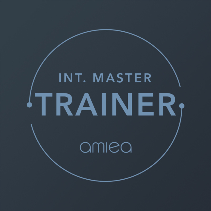 Icon for amiea international master trainer level 4 on dark grey background