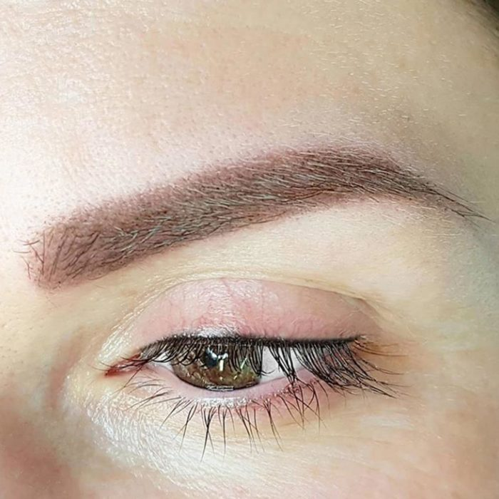 Natural eyebrows with permanent makeup (PMU) by amiea International Master Trainer Olga Hendricks, example PMU treatment eyebrows, close-up